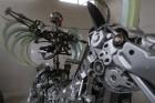 Moto & Metal NESTER CUSTOM mākslas galerija Preiļos ir izklaides komplekss ar izstāžu zālēm, individualizētiem motocikliem un metāla mākslas skulptūrā 12